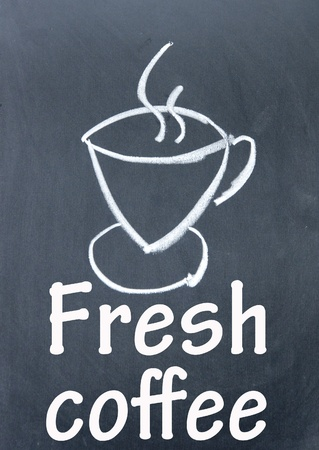 fresh coffee sign drawn with chalk on blackboard photo