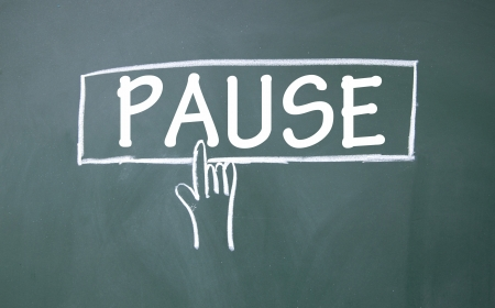 pause: abstract finger click pause sign