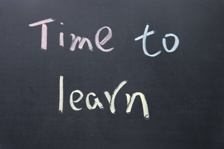 time to learn title written with chalk on blackboard photo