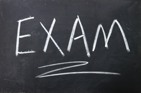 exam sign written with chalk on blackboard photo