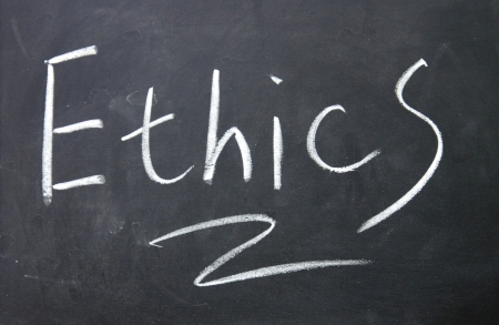 ethics sign written with chalk on blackboard photo