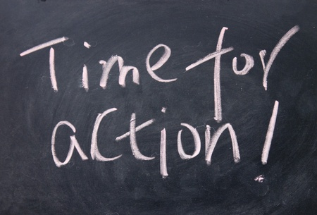 time for action title written with chalk on blackboard photo
