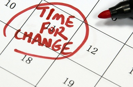 business change: time for change sign written with pen on calendar Stock Photo
