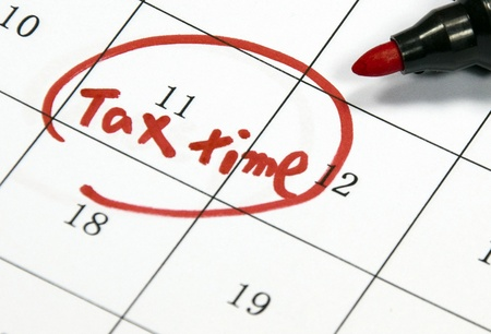 tax time sign written with pen on calendar photo