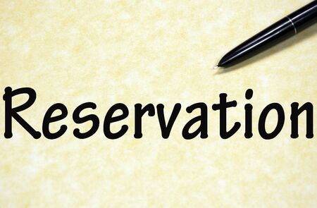 reservation: reservation sign written with chalk on blackboard