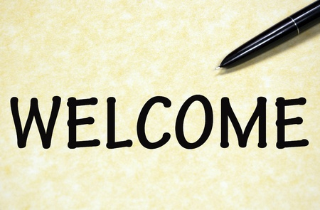 welcome sign written with pen on paper photo