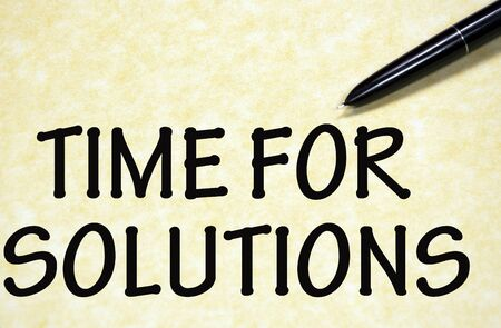 time for solutions written with pen on paper photo