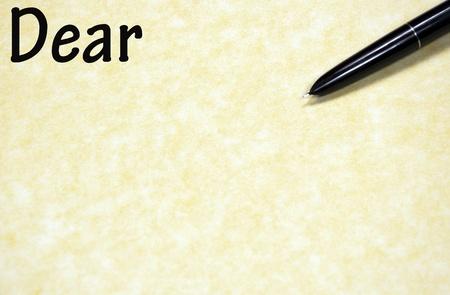dear: dear sign written with pen on paper
