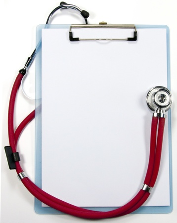 stethoscope and  blank clipboard Stock Photo