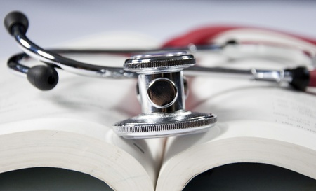 sound therapist: stethoscope and book Stock Photo