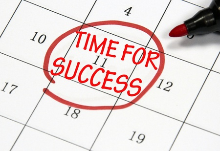 time for success sign written with pen on paper photo