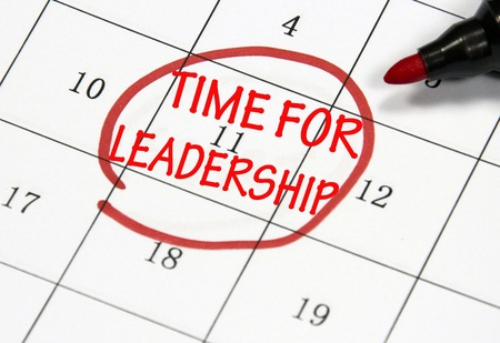 time for leadership sign written with pen on paper photo
