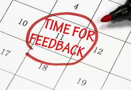 time for feedback sign written with pen on paper