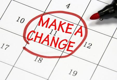 make a change sign written with pen on paper Standard-Bild
