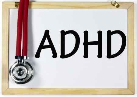 earpiece: ADHD title written on blackboard