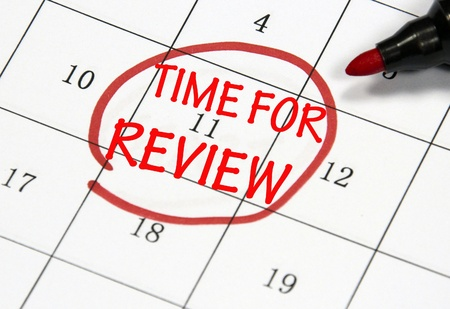 quizzing: time for review sign written with pen on paper Stock Photo