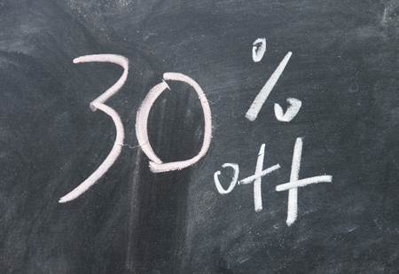 30  discount sign written with chalk on blackboard photo