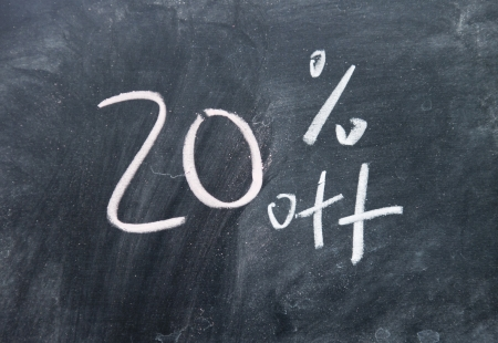 20  discount sign written with chalk on blackboard photo