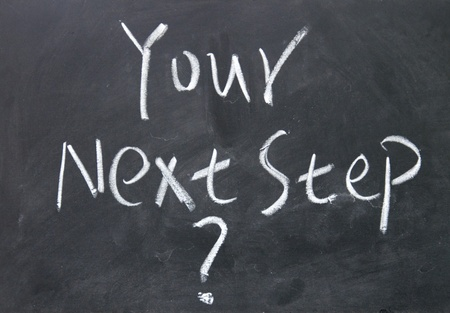 your next step   title written with chalk on blackboard Stock Photo