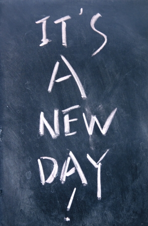 it is a new day title written with chalk on blackboard photo
