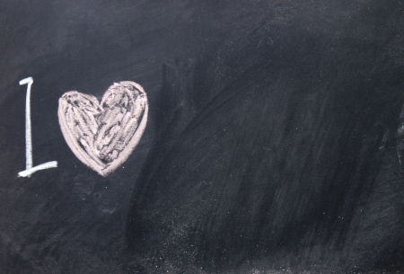 envisage: love sign drawn with chalk on blackboard