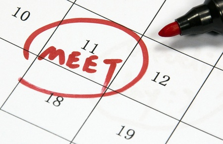 meet sign written with pen on paper Stock Photo - 18704355