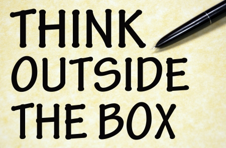 think outside the box title written with pen on paper photo