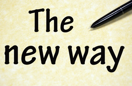 the new way title written with pen on paper photo