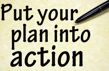 into: put your plan into action title written with pen on paper Stock Photo