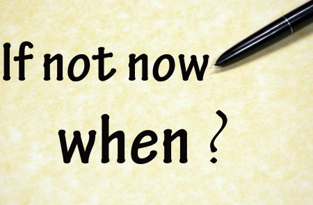 not working: if not now when title written with pen on paper Stock Photo