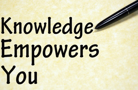 knowledge empowers you title written with pen on paper photo
