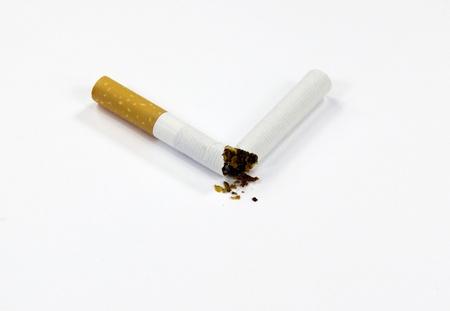 Broken cigarettes and white background photo