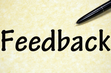 feedback title written with pen on paper Stock Photo - 18815350
