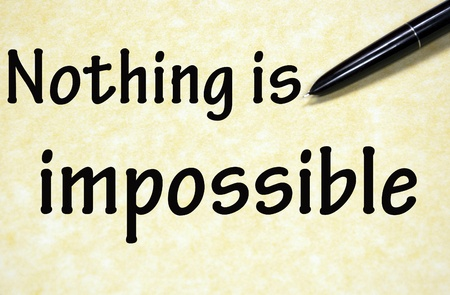 nothing is impossible title written with pen on paper photo