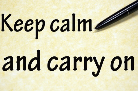 keep calm and carry on title written with pen on paper photo