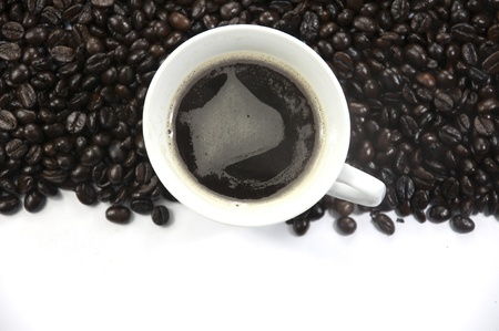 A cup of coffee and coffee beans background photo