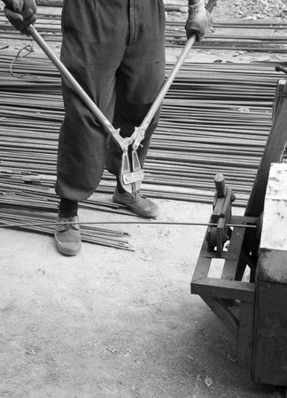 Worker cut steel with iron scissors photo