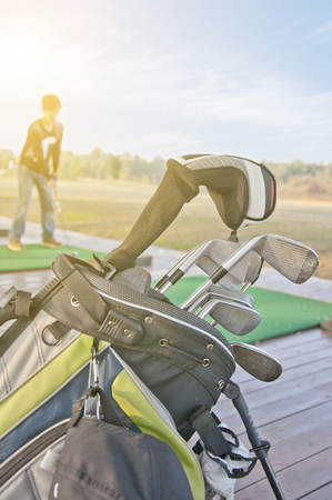 youth practicing golf