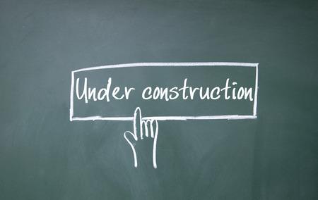 finger click under construction symbol photo