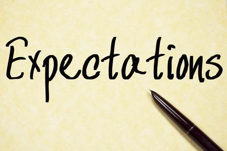 schreiben: Erwartungen Wort zu schreiben auf Papier Lizenzfreie Bilder