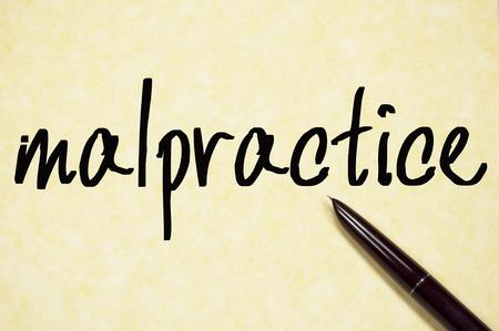 malpractice: malpractice word write on paper