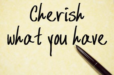cherish: cherish what you have text write on paper