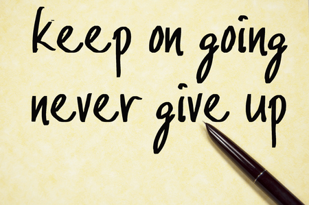 keep up: keep on going never give up text write on paper Stock Photo