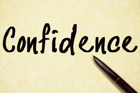 confidence: confidence word write on paper