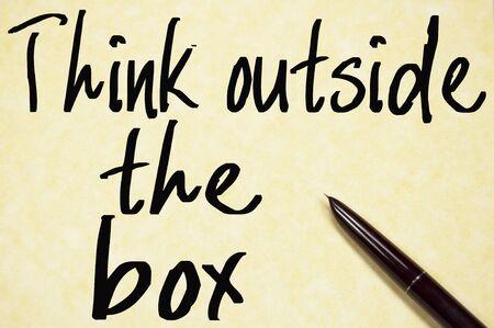 think outside the box: think outside the box text write on paper