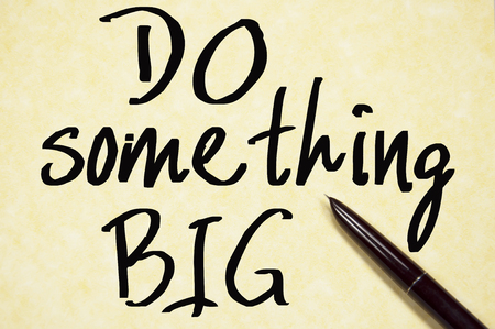do something big text write on paper photo