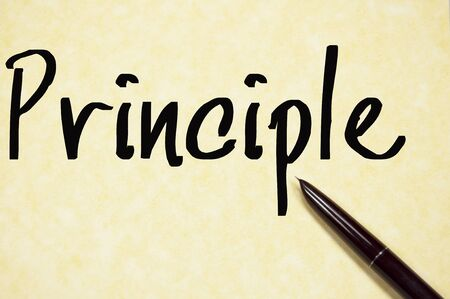principle: principle word write on paper Stock Photo
