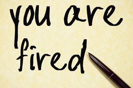 you are fired: you are fired text write on paper Stock Photo