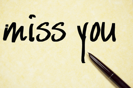 miss you: miss you text write on paper