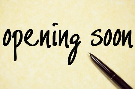 opening soon write on paper photo